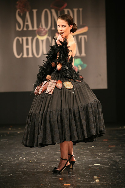 French model Clemence Castel displays a chocolate decorated dress