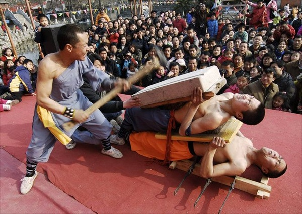 Stuntmen perform in a park to celebrate Chinese New Year in Xiangfan