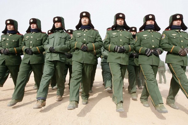 Paramilitary recruits during a training break at an army base in Shenyang, Liaoning province
