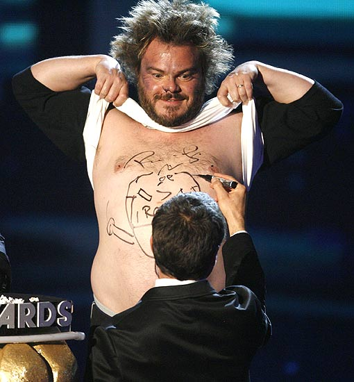 robert downey jr signs the autograph on the chest of jack black