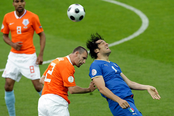 luca toni of italy and andre ooijer of holland