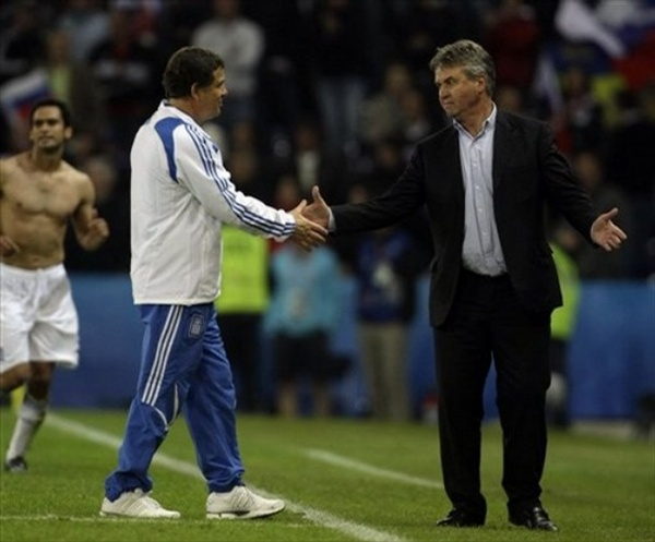 Otto Rehhagel, left, shakes hand with Russia's Dutch head coach Guus Hiddink
