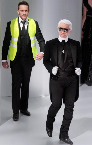 German fashion designer Karl Lagerfeld posing with a reflective vest to promote its wear