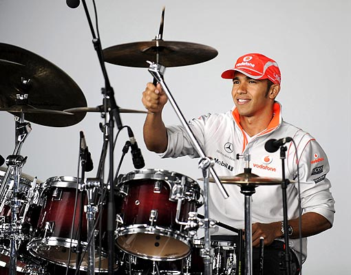 Lewis Hamilton playing drums