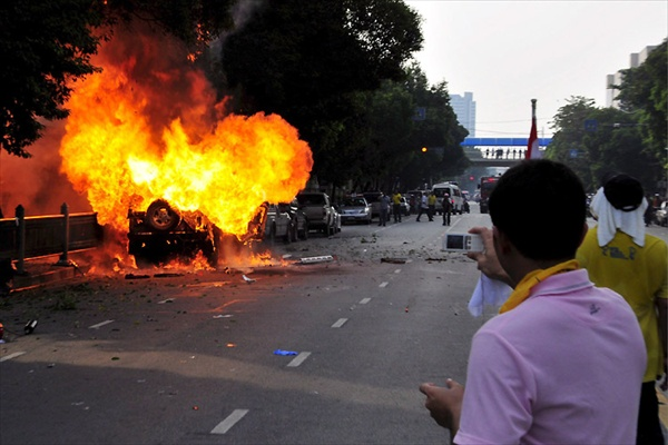 policemen fire tear gas to disperse anti-government protesters in Bangkok