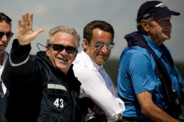 george_w_bush_with_his_dad_and_nicolas_sarkozy_boat_trip_august2007.jpg
