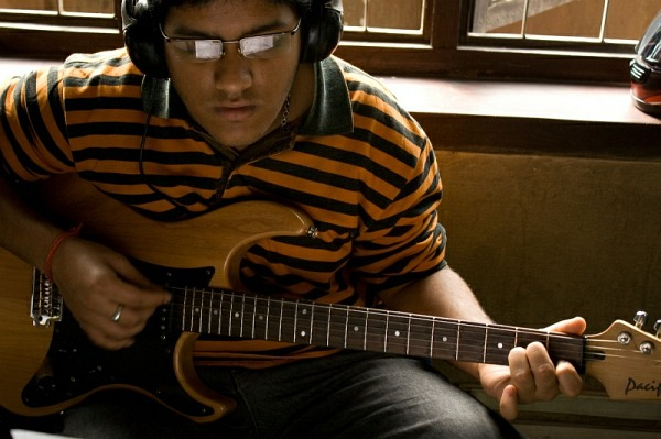 nepal_kathmandu_rockschool_orange_striped_student_IMG_0556.jpg