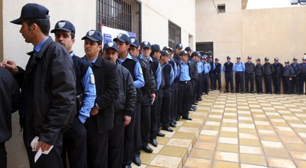 iraq_parliament_elections13_policemen_kurdish_city_arbil.jpg