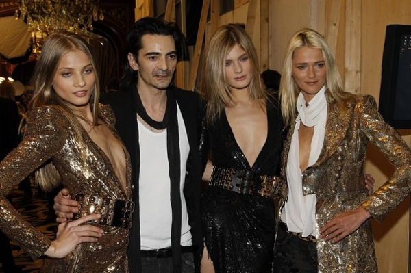 Balmain fashion designer Christophe Decarnin with models
