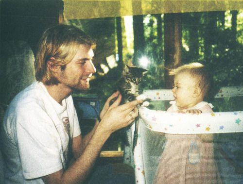 Kurt Cobain and his daughter.jpg